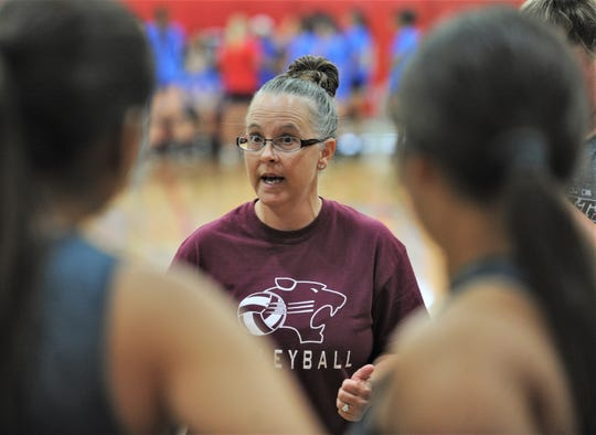 Hawley coach Amy Eckhoff talks to her team during a scrimmage against Clyde on Monday, Aug. 5, 2019, at Cooper High School in Abilene.