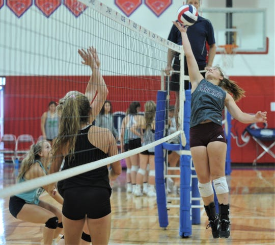 Hawley junior Breanna Leathers makes a play at the net in a scrimmage against Clyde on Monday, Aug. 5, 2019, at Cooper High School in Abilene.