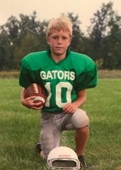This 2007 photo shows Jon Wassink in his early football days playing in the Grand Rapids area.
