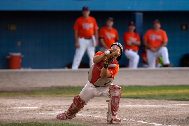 Mid Michigan Tigers catcher Zack Williams catches the ball during the opening game of the NABF World Series on Wednesday, Aug. 7, 2019 at C.O. Brown Stadium in Battle Creek, Mich. The Orioles defeated the Tigers 4-2.