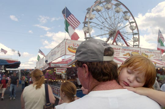 Stephanie Nichols, 3, of New Milford, Pennsylvania, takes a nap on the shoulders of her dad, Brian, during the 149th Harford Fair in 2006.