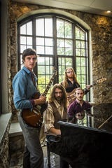 The Travers Brothership, which features four Black Mountain natives Kyle Travers (left), his twin brother Eric, (seated left), Ian McIsaac (seated right) and Josh Clark, is flying high after performing five shows in five days at FloydFest.