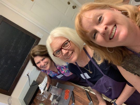 Connie Harvey, Ruth Prather and Suzy Fleming Leonard create a little magic in the Gathering Table kitchen.