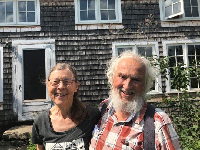 Anne and Jack Lazor in front of their farmhouse at Butterworks Farm.