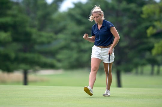 Chloe Levins reacts after rolling in a par putt on the ninth hole during the final round of the 2019 Vermont women's amateur golf championship at Ralph Myhre Golf Course in Middlebury on Thursday, Aug. 8.