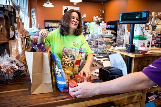 Jennifer Baird, owner of Earthwise, rings up a customer at the new pet supply store on the Southside on Thursday, August 8, 2019.