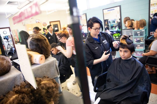 Del Mar College summer dual credit cosmetology students give free back-to-school haircuts to students in kindergarten through 12th grade on Thursday, Aug. 8, 2019.