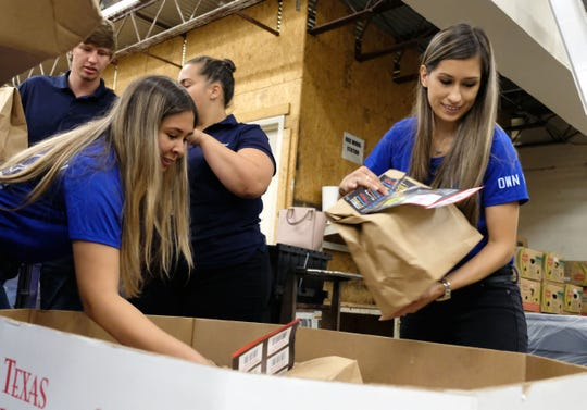 United Way of the Coastal Bend volunteers sort and organize bags  of school supplies as a part of Operation Supply our Students.