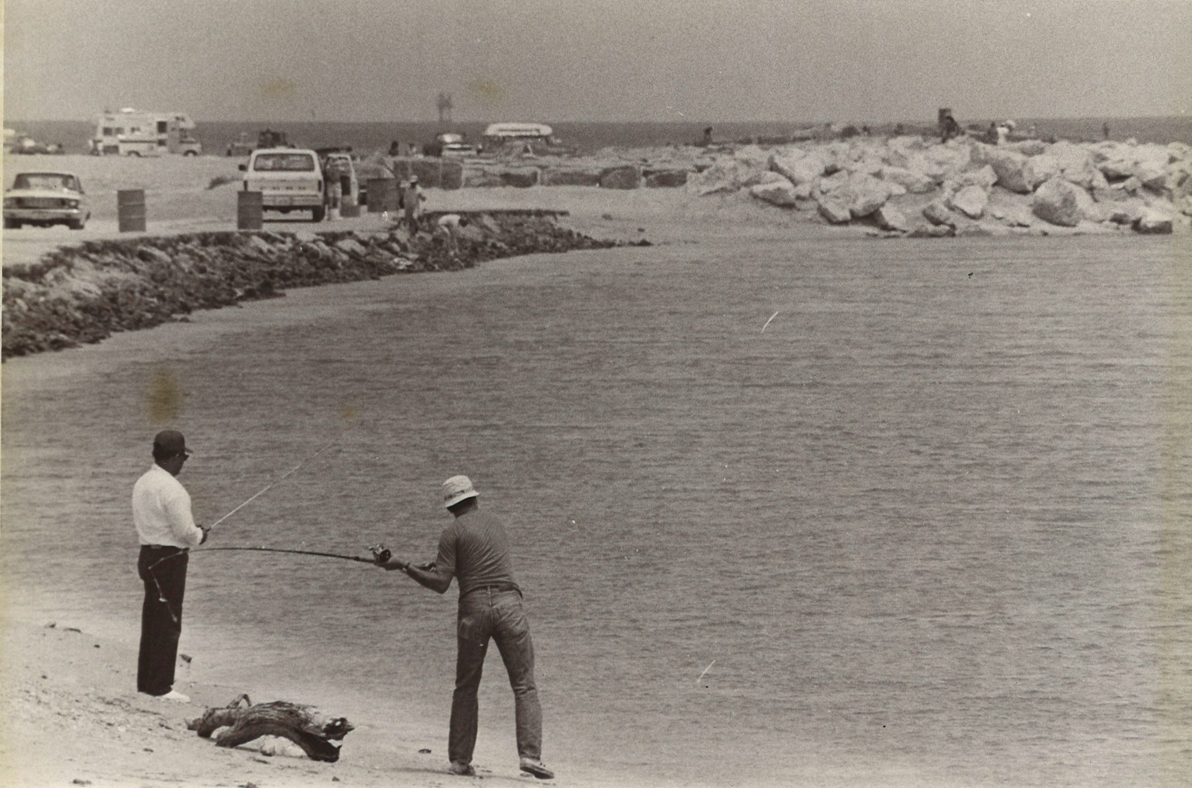 Fishermen at Fish Pass in Mustang Island State Park in August 1972. The pass was dredged in the '70s. Following the Ixtoc oil spill, the Coast Guard filled in the pass to prevent oil from reaching Corpus Christi Bay. Hurricane Allen cleared it back out, but it silted back up and remains closed.