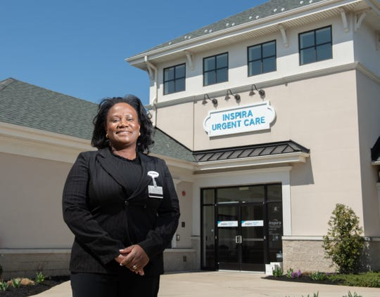 Dr. Evelyn Balogun, Medical Director Inspira Health Occupational Medicine at Inspira Health Urgent Care Tomlin Station in Harrison Township, Thursday April 4, 2019.