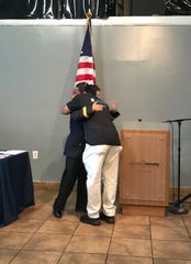 Antonne Henshaw (right) hugs Camden County Jail Warden Karen Taylor at an event that connected people returning from incarceration with services.