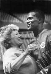 Cincinnati Reds owner Marge Schott with Reds centerfielder Eric Davis during a Reds workout at Riverfront Stadium.