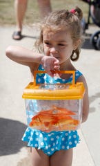 Madison Johnson, 4, with the four fish she caught at the Springdale's Goldfish Swim in 2010.