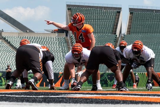 Bengals quarterback Andy Dalton (14) commands the offense during Bengals training camp on Thursday, August 8, 2019 inside of Paul Brown Stadium