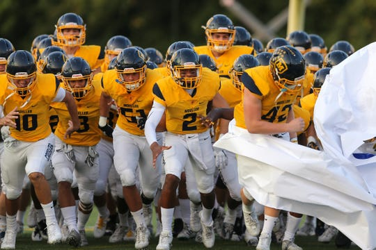 The Moeller Crusaders take the field before the high school football game between the St. Xavier Bombers and Moeller Crusaders, Friday, Sept. 22, 2017, at Roettger Stadium in Lockland, Ohio.