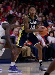Northern Arizona guard Karl Harris (14) in the first half during an NCAA college basketball game against Arizona, Friday, Nov. 10, 2017, in Tucson, Ariz.