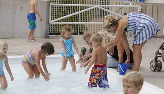 Kids chase down goldfish at the Springdale Parks and Recreation Community Center's pool for the annual Goldfish Swim in 2010.