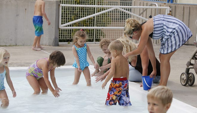 The kids were busy chasing down goldfish at the Springdale Parks and Recreation Community Center's pool for the annual Goldfish Swim on Sept. 4, 2010.
