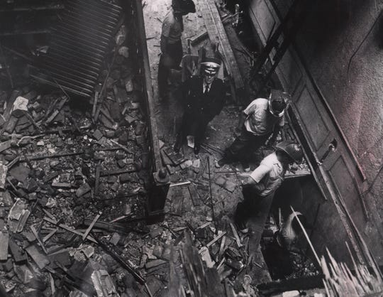 Firefighters look for bodies in the tornado debris on Aug. 10, 1969.