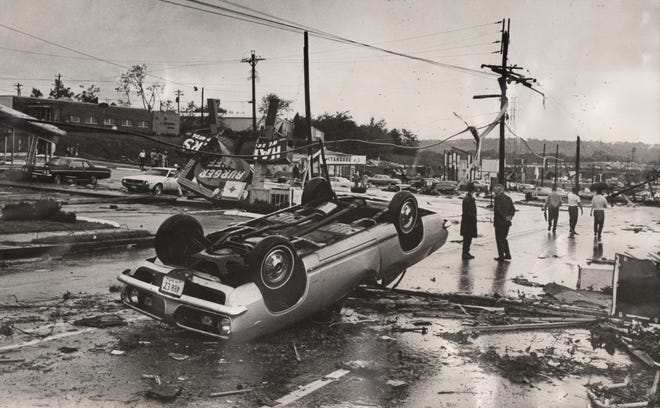 An overturned car and wrecked buildings show the extensive damage of a tornado that touched down near Galbraith and Reading roads on Aug. 9, 1969.