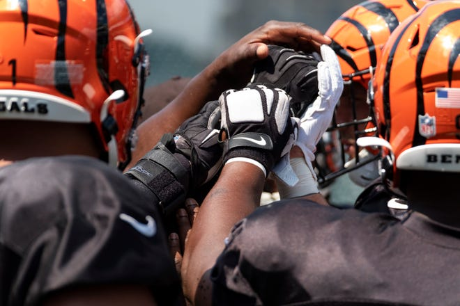Bengals defensive players gather together at Bengals training camp on Thursday, August 8, 2019 inside of Paul Brown Stadium