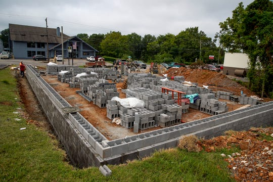 Workers construct the new building for the shooting range where the old one sat at Clarksville Guns & Archery on Thursday, Aug. 8, 2019.