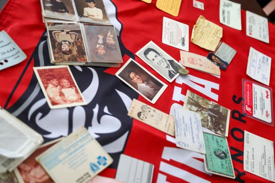 Pictures and cards recovered from an old billfold believed to have been lost 32 years ago can be seen sprawled across the table at the McQueen household in Clarksville, Tenn., on Wednesday, Aug. 7, 2019.