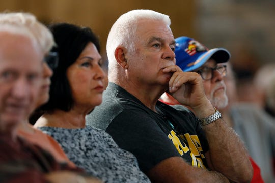 Audience members listen to Democratic presidential candidate former Vice President Joe Biden speak at a community event, Wednesday, Aug. 7, 2019, in Burlington, Iowa. (AP Photo/Charlie Neibergall)