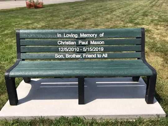Pictured is a bench dedicated to Christian Maxon, an 8-year-old Marshalltown boy killed May 15, 2019,  by a motorist while he was walking home from school. The bench was paid for by the Marshall County Landfill.