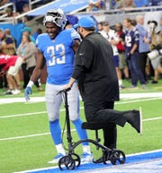 Detroit Lions head coach Matt Patricia talks with Kerryon Johnson on the field before action against the New England Patriots, August 8, 2019 at Ford Field.