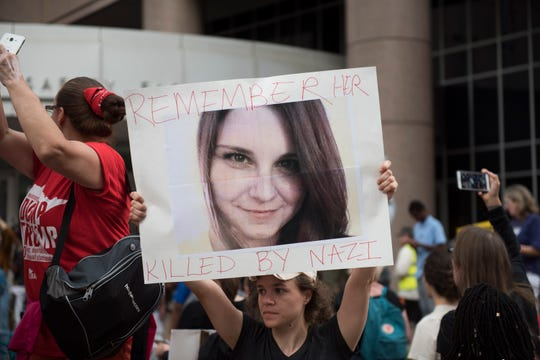 A protesters carries an image of Heather Heyer during a demonstration against racism and the violence over the weekend in Charlottesville, Virginia on August 14, 2017 in Minneapolis, Minnesota. Protesters estimated at more than 1,000 blocked streets and light rail during the action.  (Photo by Stephen Maturen/Getty Images)