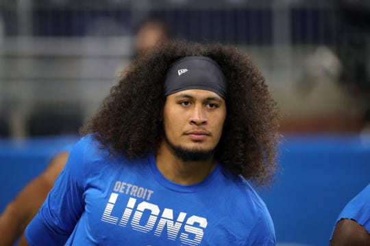 Detroit Lions linebacker Jahlani Tavai warms up before action against the New England Patriots, August 8, 2019 at Ford Field.