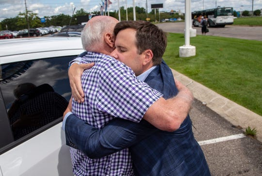 Bill Belcher, 79, of Farmington Hills, left, a vet in need, was the recipient of a new 2019 Trax on Thursday, July 8, 2019 thanks to businessman and philanthropist Bill Pulte as they hug outside of Joe Lunghamer Chevrolet in Waterford.