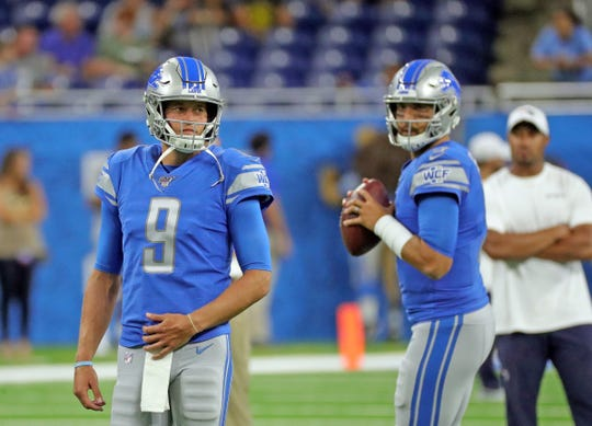 Matthew Stafford watches warmups before action against Patriots, Aug. 8 at Ford Field.