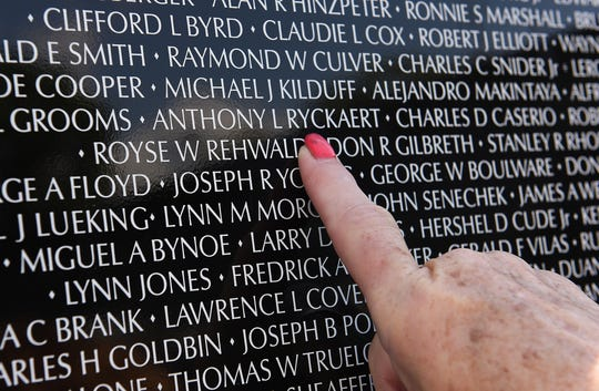 Debra Teddy, 64, of Garden City points to the name of her first cousin Anthony Lee Ryckaert, who died in Vietnam.