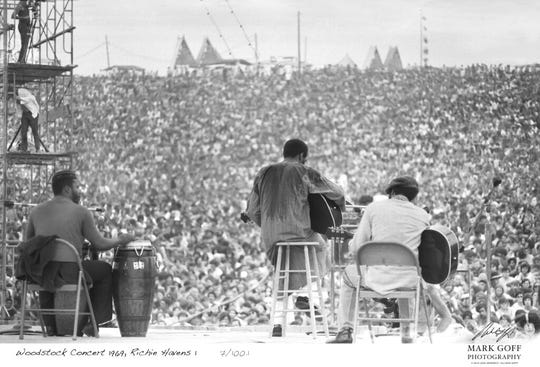 This August, 1969 photo shows Richie Havens as he performs during Woodstock in Bethel, N.Y.