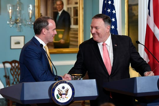 Secretary of State Mike Pompeo, right, shakes hands with Britain's Foreign Secretary Dominic Raab, left, during a press availability at the State Department in Washington, Wednesday, Aug. 7, 2019.