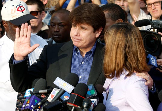 In this March 14, 2012, file photo, former Illinois Gov. Rod Blagojevich, with his wife Patti at his side, speaks to the media in Chicago before reporting to federal prison in Denver.