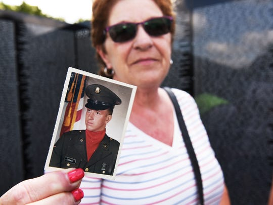 Debra Teddy, 64, of Garden City holds a photo of her first cousin Anthony Lee Ryckaert, who was 19 when he died in Vietnam.
