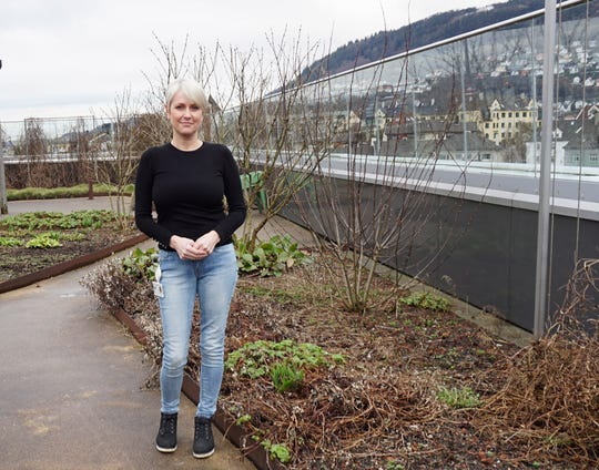 Vibecka Hellesund, standing in the roof-top garden at Kronstad outpatient psychiatric clinic in Bergen, Norway, received at-home visits from a psychiatric nurse once or twice a week while recovering from bipolar disorder. She's now a peer support expert who helps others with severe mental illness.