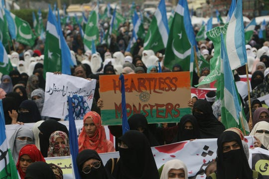 Supporters of the Pakistani religious party Jamaat-e-Islami rally against India in Karachi, Pakistan, Thursday, Aug. 8, 2019.