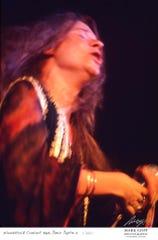 This August, 1969 photo shows Janis Joplin as she performs during Woodstock in Bethel, N.Y.