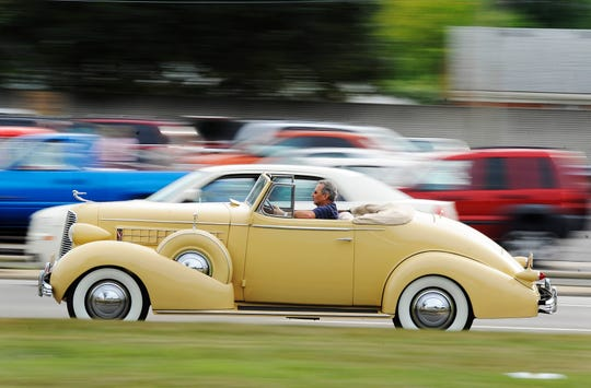 A stylish classic car cruises on Woodward near 13 1/2 Mile in 2010.