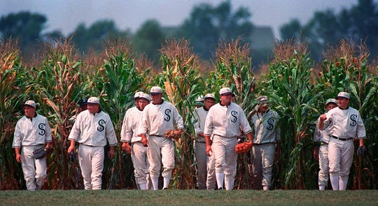 """Actors portraying ghost players emerge from a cornfield as they reenact a scene from the movie """"Field of Dreams"""" at the movie site in Dyersville, Iowa."""