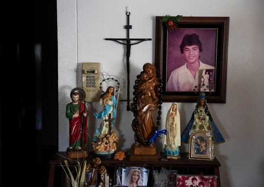 A shrine sits in the home of David Sablan, president of Concerned Catholics of Guam, whose son, Maynard, was killed in a shooting at his school in 1984, in Santa Rita, Guam, Wednesday May 8, 2019.