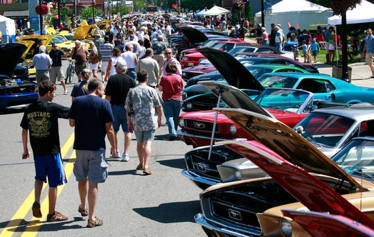 Cruise-goers check out Ford's Mustang Alley on Nine Mile in Ferndale.