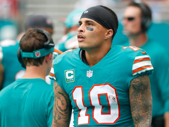 In this Dec. 9, 2018, file photo, Miami Dolphins wide receiver Kenny Stills (10) stands along the sideline during the first half of the team's NFL football game against the New England Patriots in Miami Gardens, Fla.