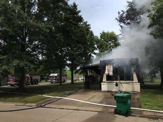 Firefighters on scene at a mobile home fire at 1821 Asbury Drive in Evansville.