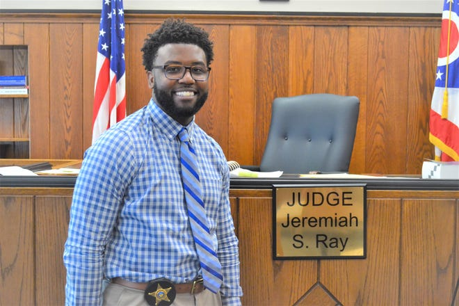 Greggory Brown stands in the courtroom where he serves as bailiff for Sandusky County Common Pleas Court Judge Jeremiah Ray. Brown transformed a lost dream of playing in the NFL into a new passion for law enforcement. Not only is he a bailiff, but he will soon be sworn in as a reserve officer with the Fremont Police Department. And he still fuels his passion for football as a Ross football coach.