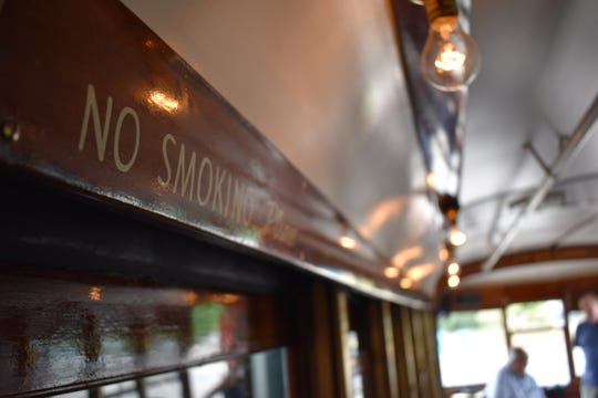 "The interior of Car 25 is nearly done, featuring details like this ""No Smoking"" sign."